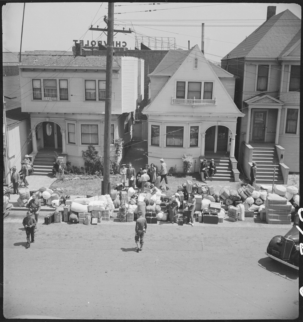 Oakland, California. Baggage of evacuees of Japanese ancestry piled on the sidewalk_NARA