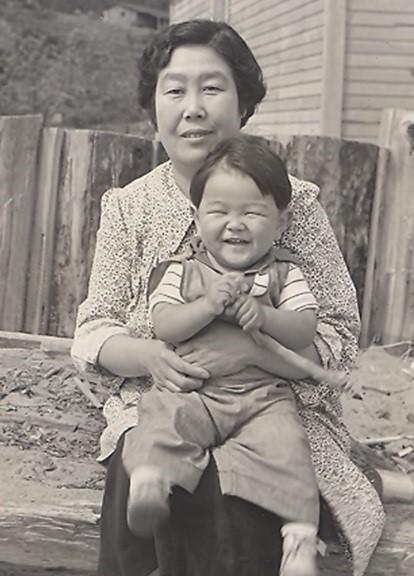 Toku Shimomura with grandson, Roger, circa 1940. Smithsonian Asian Pacific American Center